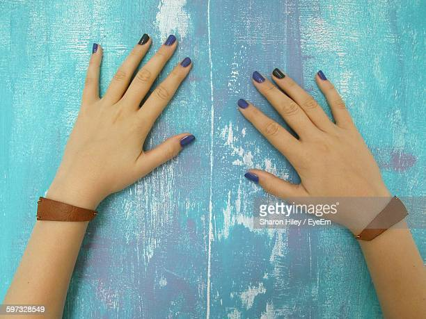 Cropped Image Of Woman Hands On Weathered Wall