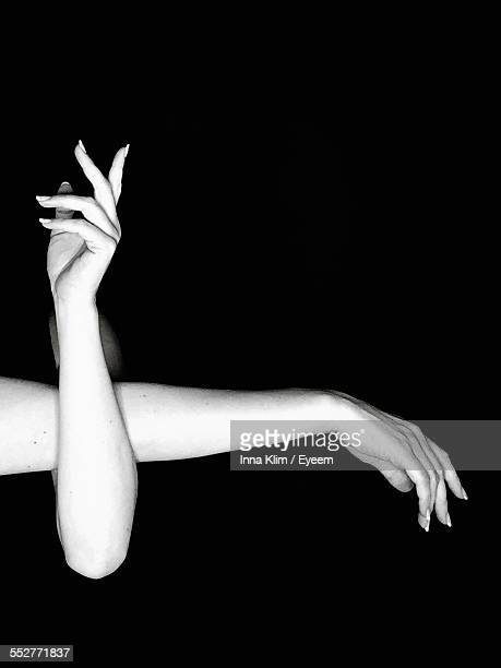 Cropped Image Of Woman Hands Over Black Background