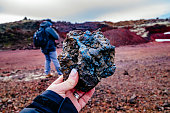 Cropped Image Of Woman Holding Volcanic Rock