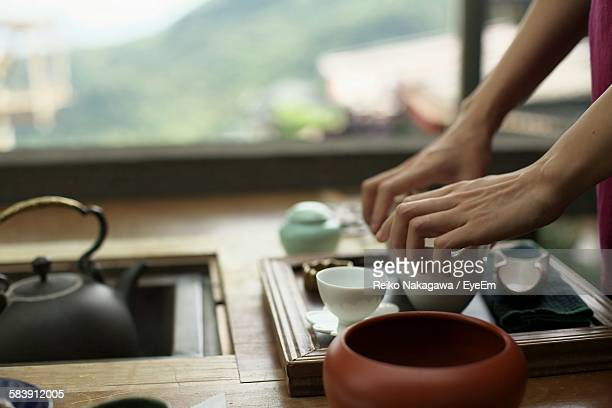 Cropped Image Of Woman Preparing Tea In Kitchen At Home
