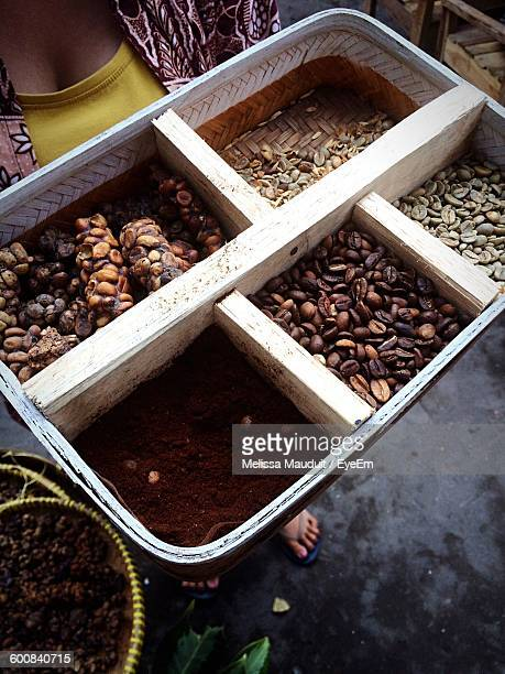 Cropped Image Of Woman With Coffee Beans In Container