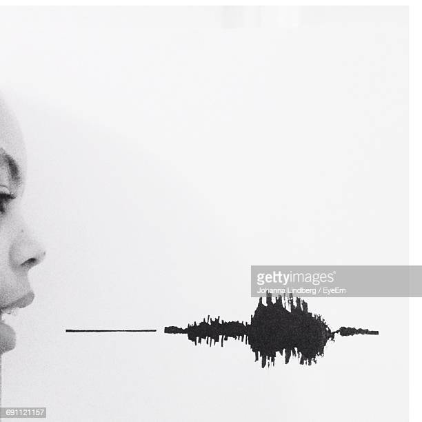 Cropped Image Of Woman With Sound Waves Against White Background