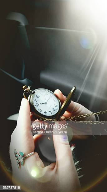 Cropped Image On Woman Holding Pocket Watch