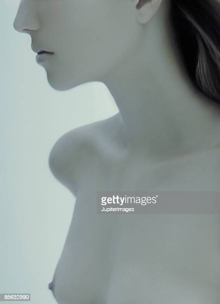Cropped Nude Woman's Face and Breasts