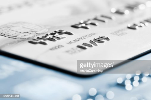 Cropped section of credit card with selective focus