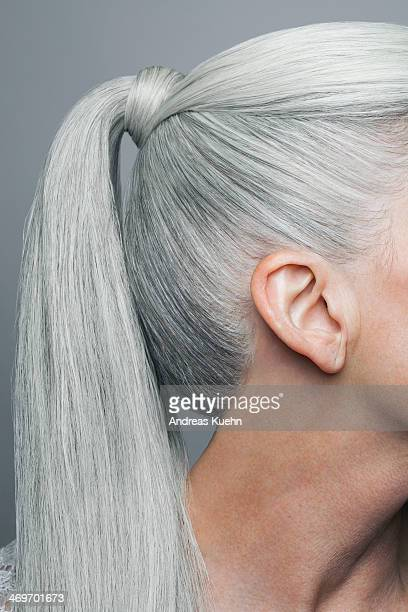 cropped shot of grey haired ponytail, profile.