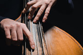 cropped shot of man playing bass violoncello