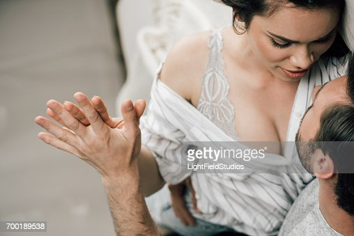 Cropped Shot Of Passionate Young Couple Holding Hands In Foreplay At Home Stock Photo