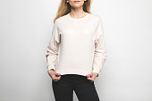 cropped shot of woman in blank sweatshirt on white