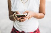 Cropped shot of young woman texting on smartphone
