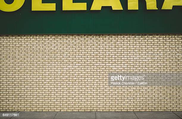 Cropped Store Sign On Brick Wall