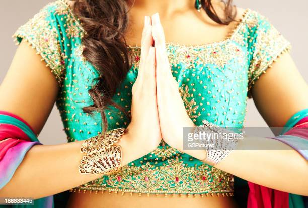 Cropped View of Indian Woman with Hands in Prayer Position