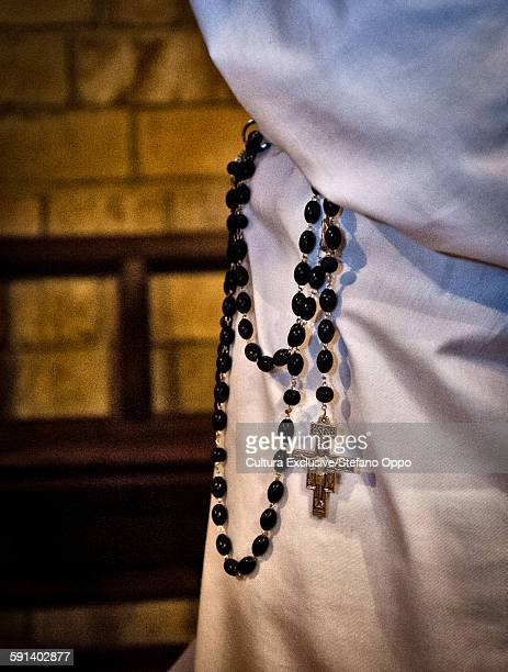 Cropped view of member of the Confraternity of the Rosarys traditional fifteen decade rosary, Sardinia, Italy