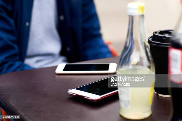 Cropped view of smartphones on table