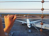 Cropped Woman Hand On Security Fence In Haneda Airport