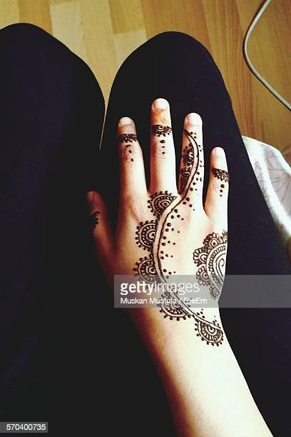 Cropped Woman Hand With Henna Tattoo