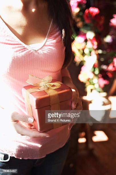 Cropped woman holding gift