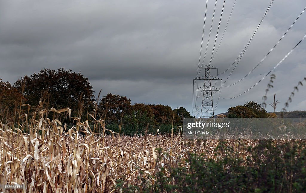 Crops grow below a existing power line crossing the Mendip Area of Outstanding National Beauty close to the village of Christon on November 6, 2012 in Somerset, England. The National Grid released today its draft Hinkley C to Avonmouth connection route which would involve replacing existing pylons with fewer but larger ones and will also use underground cables in the Mendip Area of Outstanding National Beauty. However campaigners how have been fighting against the new power line, have claimed the proposals will still have a detrimental effect on the landscape.
