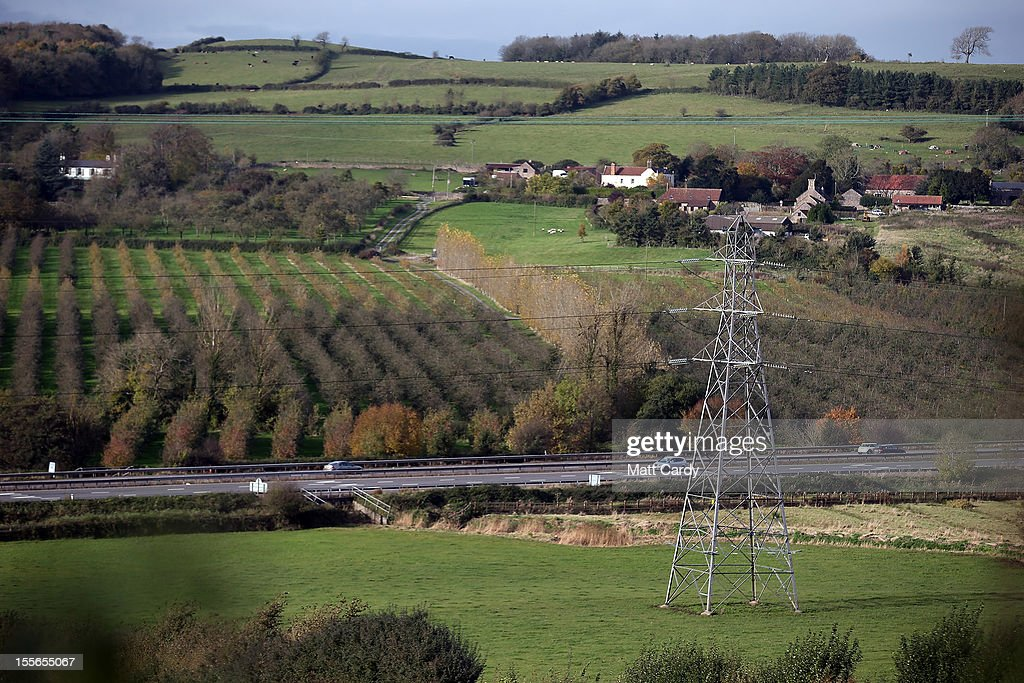 Crops grow beside the existing power line crossing the Mendip Area of Outstanding National Beauty close to the village of Christon on November 6, 2012 in Somerset, England. The National Grid released today its draft Hinkley C to Avonmouth connection route which would involve replacing existing pylons with fewer but larger ones and will also use underground cables in the Mendip Area. However campaigners how have been fighting against the new power line, have claimed the proposals will still have a detrimental effect on the landscape.