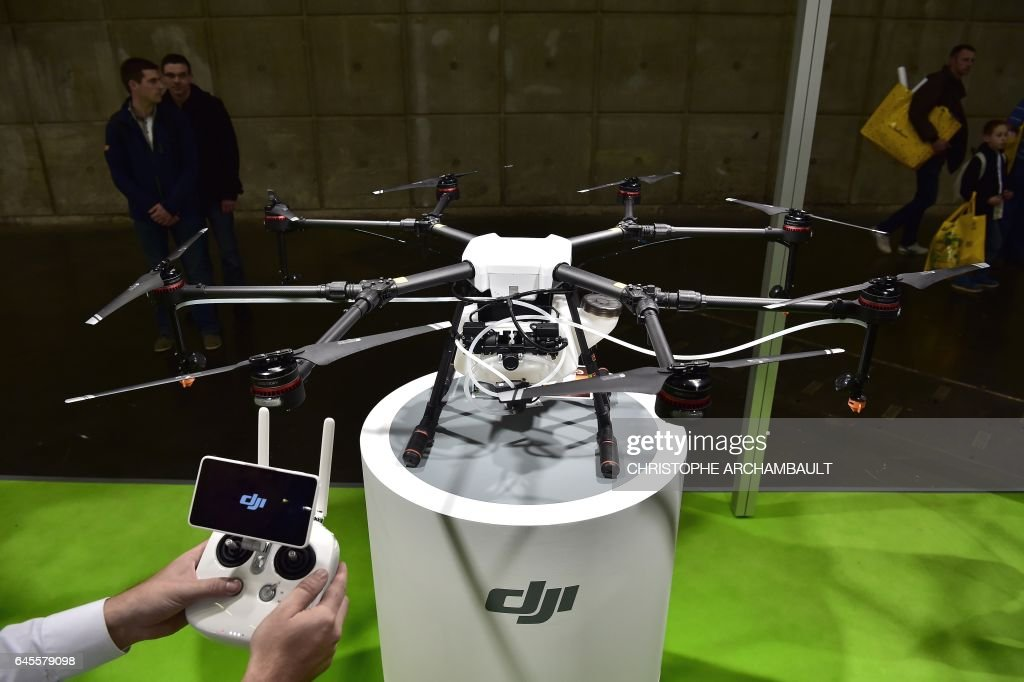 A DJI crop-spraying drone is displayed during the SIMA (Mondial des Fournisseurs de l'Agriculture et de l'Elevage) 2017 at the Parc des Expositions Paris Nord in Villepinte on February 26, 2017. / AFP / CHRISTOPHE