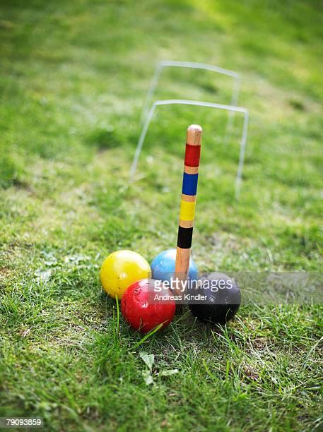 Croquet balls on a lawn.