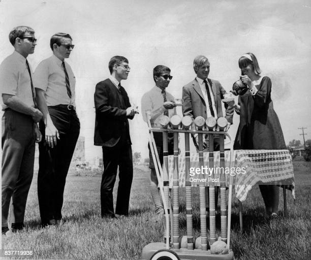 Croquet can be a tiring sport and here the young gentlemen line up for tea while Chris Barr right pours From left they are Rick Harding Bob Barr Mike...