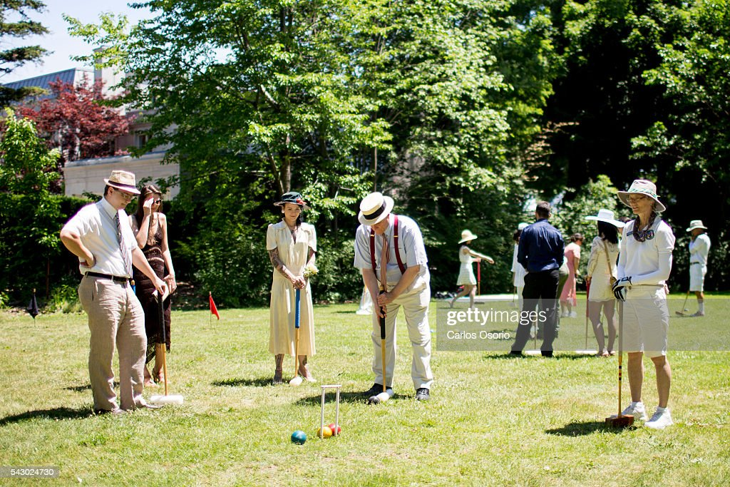 TORONTO, ON - JUNE Croquet was played on the lawn. Gatsby Garden Party is a revival event at the Spadina Museum based on Scott Fitzgeralds novel The Great Gatsby with music, food and drinks from the roaring 1920s. Over the soft, sweet tones of cool jazz, guests participate in a costume contest, or play a game of croquet.June 25, 2016.