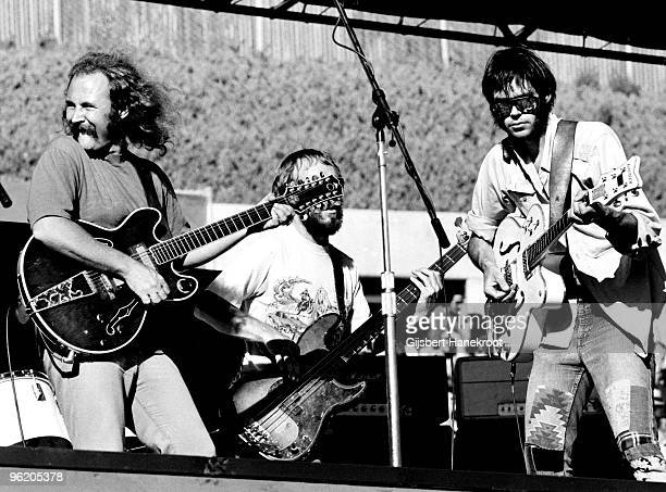 Crosby Stills Nash Young perform live on stage at Oakland Stadium California on July 14 1974 during their 1974 US Tour LR David Crosby Tim Drummond...