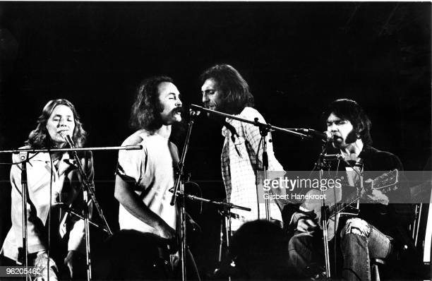 Crosby Stills Nash Young perform live on stage at Wembley Stadium on September 14 1974 LR Joni Mitchell David Crosby Graham Nash Neil Young