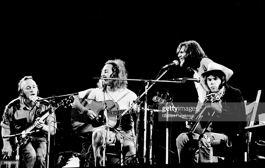 Crosby Stills Nash Young perform live on stage at Wembley Stadium on September 14 1974 LR Stephen Stills David Crosby Graham Nash Neil Young