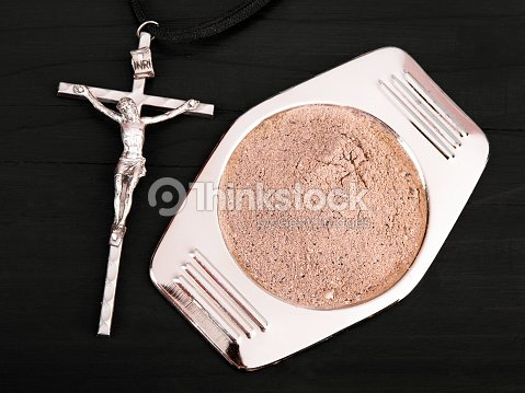 Cross And Ash Symbols Of Ash Wednesday Stock Photo Thinkstock
