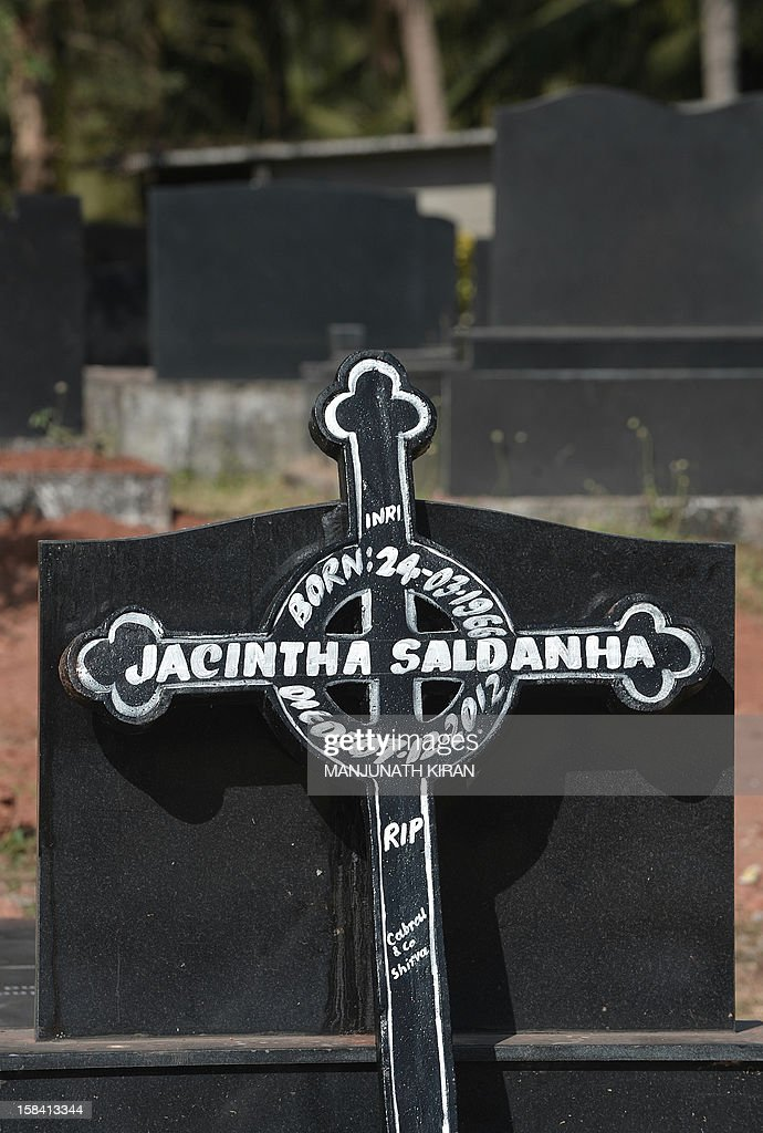 A cross bearing the name of Jacintha Saldanha, 46, is placed on a grave at the Shirva Church Cemetery, at her in laws village, north of Mangalore on December 16, 2012. The body of an Indian-born nurse, Saldanha, found dead after taking a hoax call to the hospital treating Prince William's wife was due to arrive in Mangalore following a mass in her memory held in London. Saldanha was found hanged days after answering the prank telephone call from two Australian radio DJs posing as British royals to the hospital where Catherine was admitted during the early stages of her pregnancy. AFP PHOTO/ Manjunath Kiran
