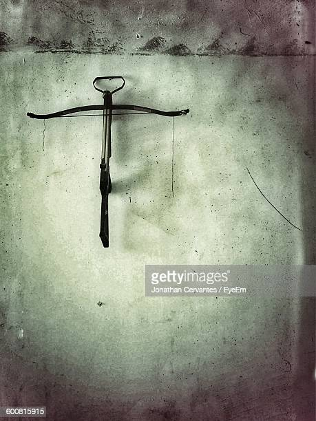 Cross Bow Hanging On Wall