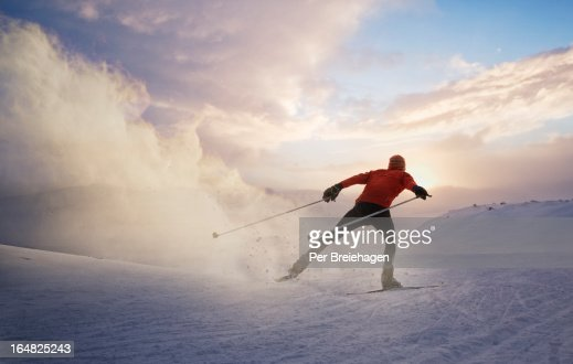 A cross country skier at sunset in Norway