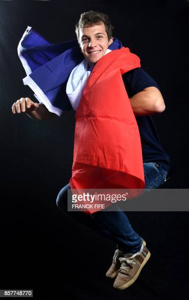 Cross country skier Clement Parisse poses on October 4 2017 in Paris during the presentation of the French delegation to the Winter Olympic Games in...