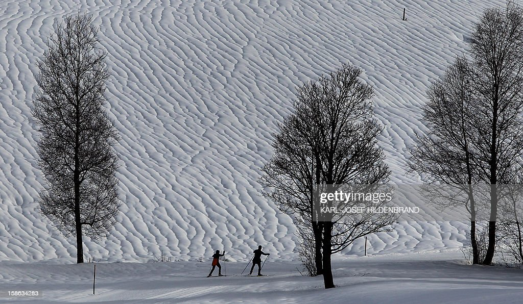 Cross country skier practice near Unterjoch, southern Germany, on December 22, 2012. Raised temperatures around 6 dgrees led to melting snow in southern part of Germany.