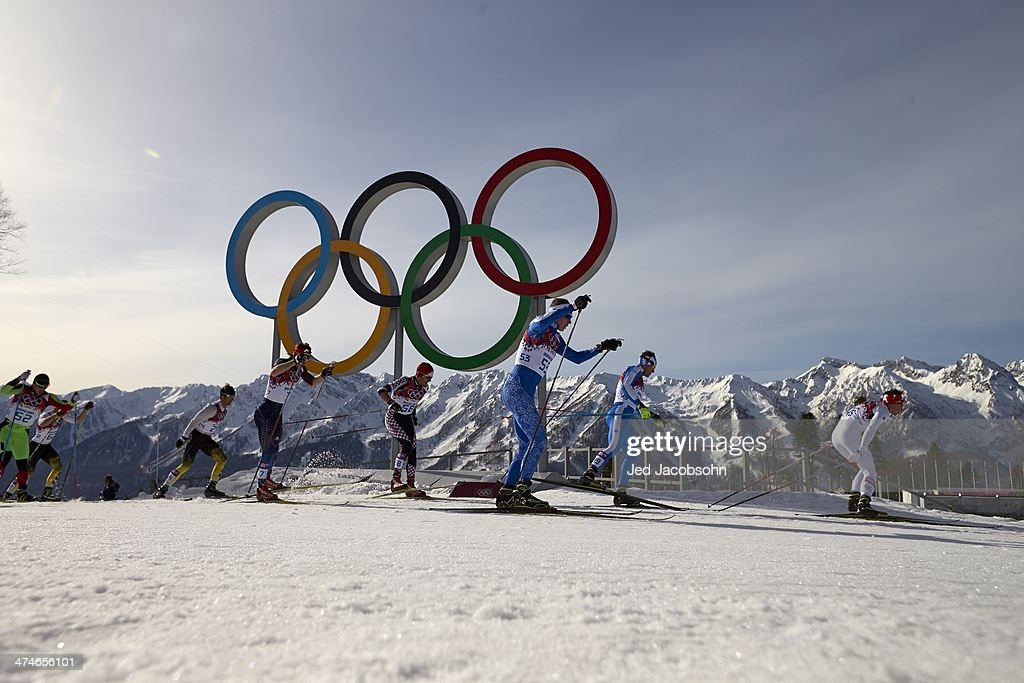 Overall view of action during Men's 50K Mass Start Free race at Laura Cross-Country Ski & Biathlon Center. View of Olympic rings in background. Krasnaya Polyana, Russia 2/23/2014 Jed Jacobsohn F130 )