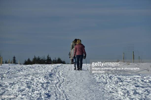 Cross country skiing between snow and sky