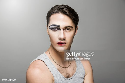 Cross dresser with half of face made up.