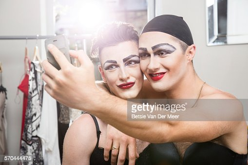 Cross dressers taking selfies of themselves