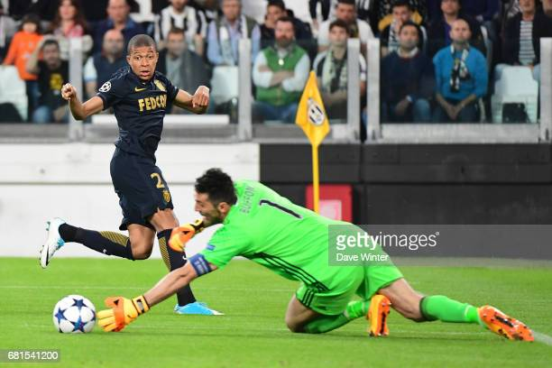 A cross from Kylian Mbappe of Monaco evades goalkeeper Gianluigi Buffon of Juventus during the Uefa Champions League match semi final second leg...