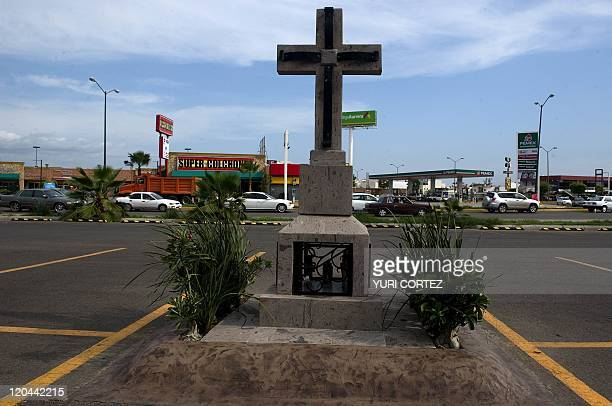 A cross in the parking lot of a commercial center points the site where Edgar Guzman Beltran son of Joaquin 'Chapo' Guzman the fugitive leader of the...