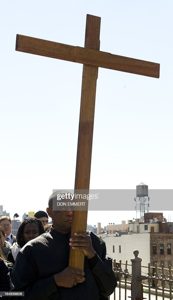A cross is carried across the Brooklyn Bridge as part of Communion and Liberation's 18th annual 'Way of the Cross' procession marking Good Friday on March 29, 2013 in New York. Hundreds took part in the event leading up to Sunday's observance of Easter. AFP PHOTO/Don Emmert
