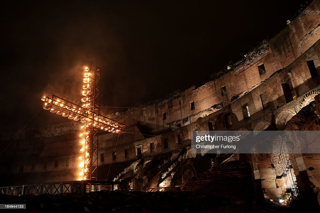 A cross lit with candles lights a section of the colosseum during the Way Of The Cross procession at the Colosseum on Good Friday March 29, 2013 in Rome, Italy. Pope Francis is taking part in his first holy week as pontiff. The traditional Catholic procession of Via Crucis on Good Friday recalls the crucifixion of Jesus Christ with Holy Week ending on Easter Sunday with the celebration of Jesus Christ's resurrection.