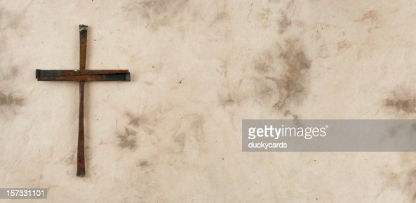 Cross Made of Rusty Nails on Grunge Background