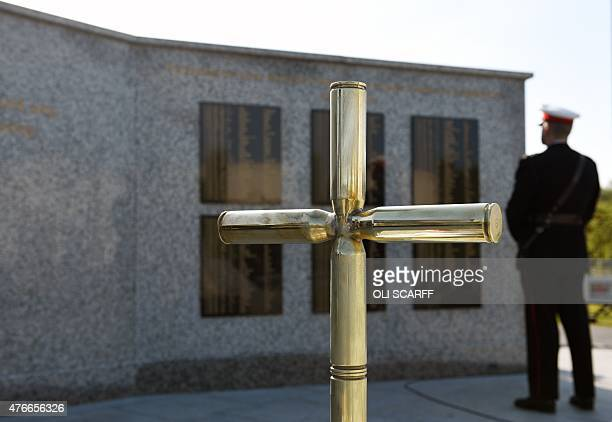 A cross made of shell casings which adorned the original Bastion Memorial Wall at Camp Bastion in Afghanistan is pictured as a member of the military...