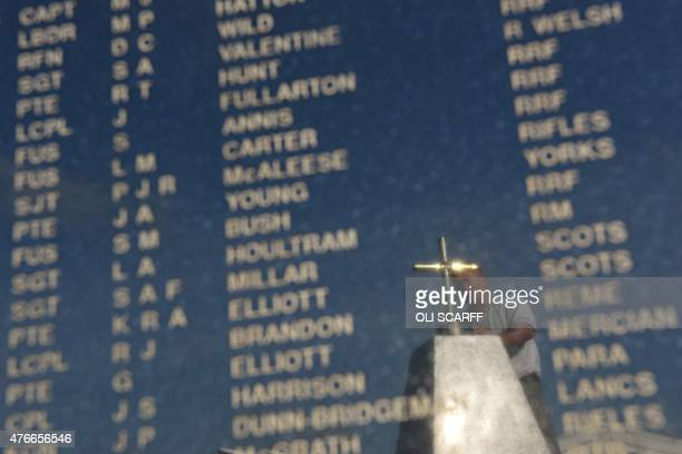 A cross made of shell casings which adorned the original Bastion Memorial Wall at Camp Bastion in the Helmand Province of Afghanistan is polished...