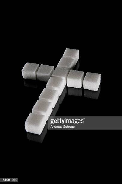 A cross made out of sugar cubes