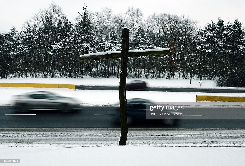 A cross marking a fatal road accident on a highway on the outskirts of the Polish capital Warsaw is seen on January 17, 2013. With Poland's roads being the deadliest in the European Union, authorities are dramatically boosting the number of radars monitoring motorists. The move has drawn the ire of Poles, concerned they will have to pay more traffic fines.
