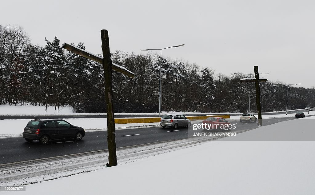 A cross marking a fatal road accident on a highway on the outskirts of the Polish capital Warsaw is seen on January 17, 2013. With Poland's roads being the deadliest in the European Union, authorities are dramatically boosting the number of radars monitoring motorists. The move has drawn the ire of Poles, concerned they will have to pay more traffic fines. AFP PHOTO/JANEK SKARZYNSKI